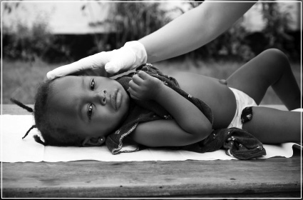 Young child getting medical treatment representing the Village Foundations healthcare projects
